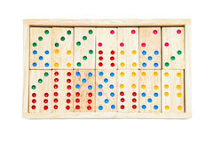 Domino game tiles in wooden case box. Isolated on white backgrou Stock Photos