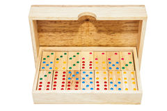 Domino game tiles in wooden case box. Isolated on white backgrou Royalty Free Stock Photos