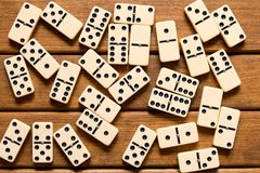 Domino game on wooden background . Top view royalty free stock image