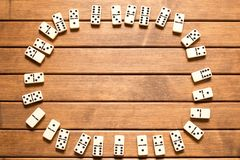 Domino game on wooden background . Top view stock photos