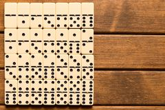Domino game on wooden background . Top view . Empty space for te royalty free stock images