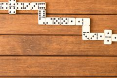 Domino game on wooden background . Top view . Empty space for te royalty free stock photo