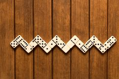 Domino game on wooden background . Top view . Empty space for te stock photography