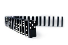 Domino lines. Domino pieces stand in a shape of corner Royalty Free Stock Image