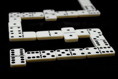 Domino match. Over black table and selective focus. Royalty Free Stock Image