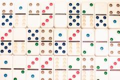Domino med kulöra prickar Arkivbilder