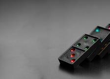 Domino na ciemnym tle Obrazy Stock
