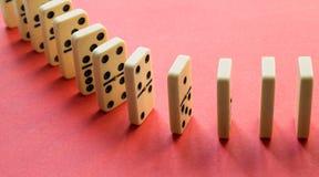 Domino op roze royalty-vrije stock foto's