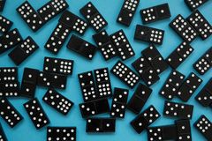 Domino pieces on the blue background stock images