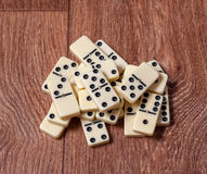 Domino pieces on the brown wooden table background.  Stock Photography