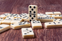 Domino pieces on the brown wooden table background.  Royalty Free Stock Photos