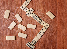 Domino pieces on the brown wooden table background.  Royalty Free Stock Images