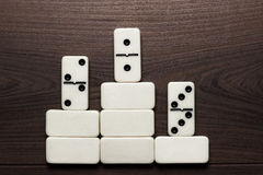 Domino pieces win concept background Stock Photo