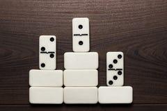 Domino pieces win concept background. Domino pieces forming podium win concept background Stock Photo