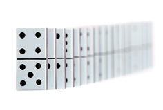 Domino pieces in a line Royalty Free Stock Images