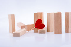Domino pieces and red heart shape Stock Photos
