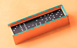 Domino pieces in a wooden box Stock Images