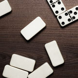 Domino pieces on the wooden table background Royalty Free Stock Photos