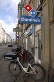 DOMINO-PIZZA BENUTZT FAHRRÄDER Lizenzfreies Stockbild
