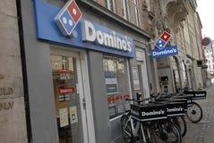 DOMINO-PIZZA BENUTZT FAHRRÄDER Stockbild