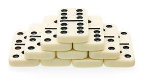 Domino pyramid building Royalty Free Stock Photography