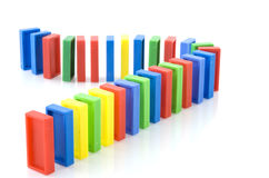 Domino rally. From plastic in different colors Royalty Free Stock Photography