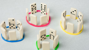 Domino represent human teams with different psyhological traits. Stock Image