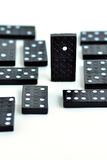 Domino standing out from the crowd concept Royalty Free Stock Images