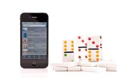 Domino sul iPhone 4 Fotografia Stock Libera da Diritti