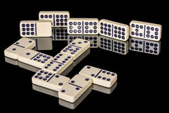Domino tiles on a reflective table Stock Photo