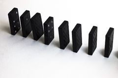 Domino effect on a white background. stock image