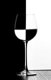 Domino wine glass Stock Photography