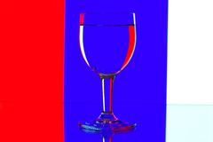Domino wine glasses on the blue and white Stock Images