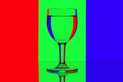Domino wine glasses on red, green and blue Stock Photos