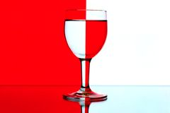Domino wine glasses on the red and white backgroun Stock Photo
