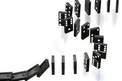 Dominoes. A stack of dominoes falling on white background with copy space Stock Images