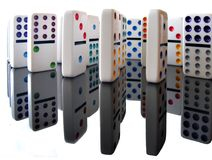 Dominoes. A close-up of dominoes pieces on a reflecting surface with white background Stock Photography