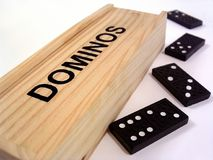 Dominoes. A wooden dominoes box and 4 dominoes Royalty Free Stock Photo
