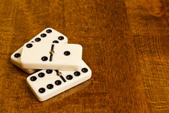 Dominoes. On wooden tavern table Royalty Free Stock Photo