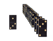 Dominoes. One domino piece out of the row Royalty Free Stock Photo