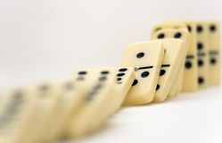 Dominoes. Close up of line of dominoes falling down Stock Image