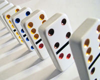 Dominoes. A line up of dominoes ready to tumble Stock Images