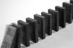 Dominoes. A row of dominoes falling Royalty Free Stock Photo