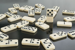 Dominoes. All domino lie, one upright royalty free stock photo