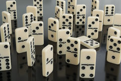 Dominoes. All domino lie, one upright royalty free stock images