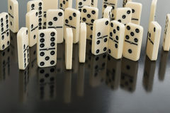 Dominoes. All domino lie, one upright stock images