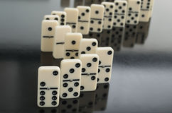 Dominoes. All domino lie, one upright stock image