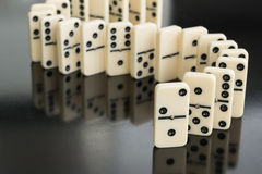 Dominoes. All domino lie, one upright royalty free stock photography