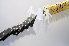 Dominoes And Papery Men Stock Photo