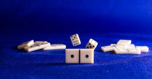 Dominoes on the background fabric. Dominoes on the background of the fabric is very popular all over the world board game, its purpose to the hands of the player Royalty Free Stock Images
